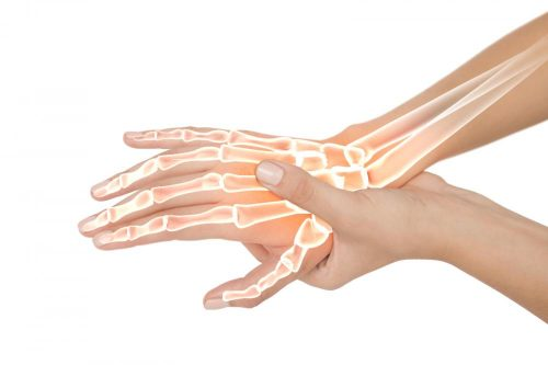 A woman's hand experiencing pain from peripheral neuropathy